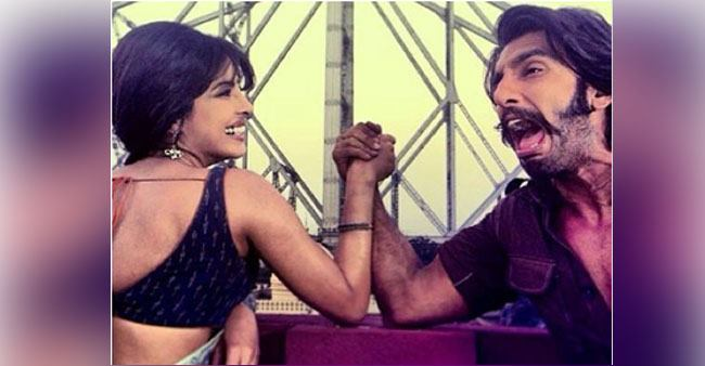 Priyanka and Ranveer's throwback arm-wrestling pic from the sets of 'Gunday' is as good as gold