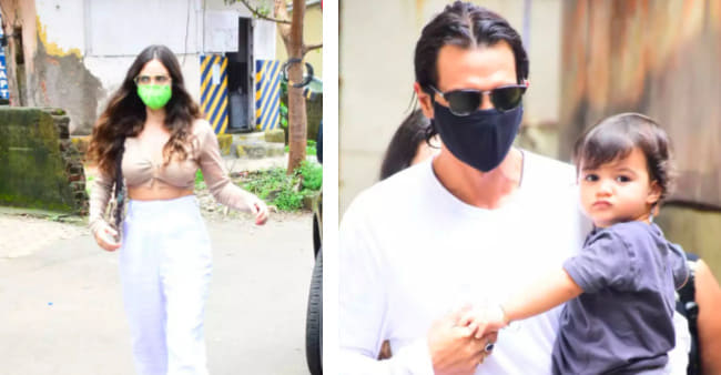 Arjun Rampal and girlfriend Gabriella take a little stroll outside with little Arik