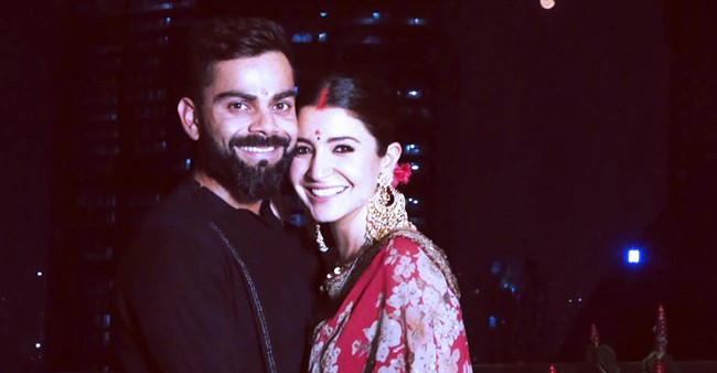 Virat and Anushka looking like an adorable couple while dressed in traditional outfits