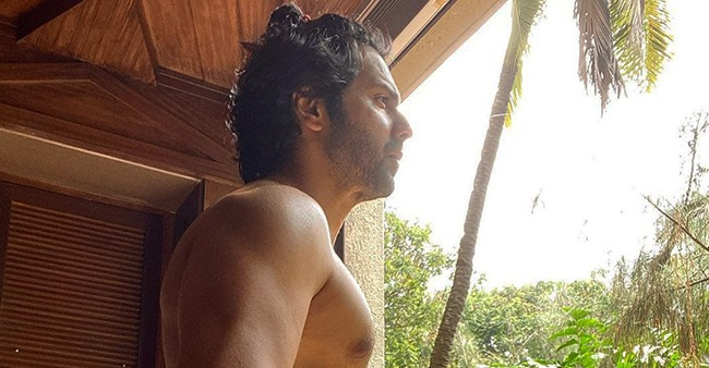 Varun Dhawan shares a stunning picture of himself showing off his chiselled body