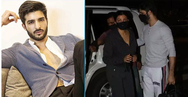 Rohman being a perfect beau as he opens the door for his lady love Sushmita like a gentleman