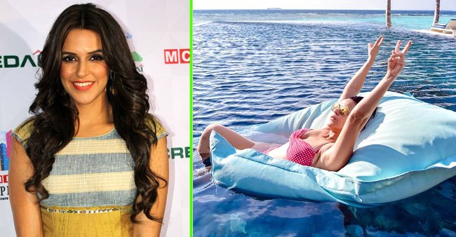 Neha Dhupia being a total water child in her new pictures featuring her swimwear