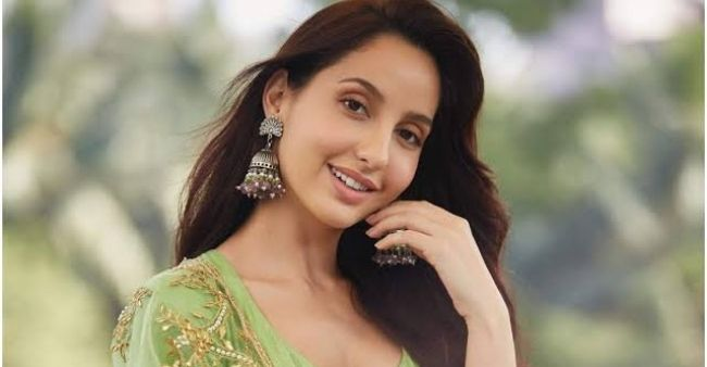 Fans can't stop droll over Nora Fatehi as she sets Instagram on fire in a white outfit